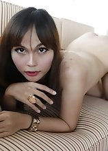 23yo busty Thai newhalf sucks a big white cock after stripping