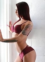 Khloe Kay shows off her goods in this one! What a perfect little body this petite TS has! Watch her strip out of her hot little burgundy lingerie and